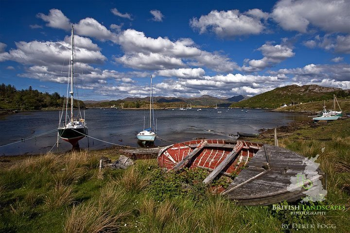 """Britain's Wonderful Wrecks - Part 2 1 Doesn't time fly. You may recall that a while back I wrote about some of Britain's Wonderful Wrecks I had come across on my photo trips and I promised you more; well almost eight months on here they are starting with some from Scotland. The first is at Ardgour which lies south-west of Fort William on the west bank of Loch Linnhe situated at the Corran Narrows on the eastern side of the Ardnamurchan Peninsula. Ardgour, its name in Gaelic translates as """"Height Of The Goat"""" was part of the ancient trade route to the Inner Hebrides, the original """"Road To The Isles"""". I was passing Ardgour on my way through the Ardnamurchan Peninsula and came across """"Capri"""" beached on the shore. It's a fishing boat that was built in Sweden in 1949 and now lies abandoned some 60 years later.   """"Capri"""" - Loch Linnhe - Ardgour   Staying on the west coast of Scotland in Wester Ross we visit Badachro (Gaelic Bad a' Chrodha) meaning cattle fold clump. A remote fishing village about 2 miles south of Gairloch. It is idyllically situated on an inlet of Loch Gairloch. Sheltered by several islands the bay provides a safe anchorage for fishing boats and yachts. At the end of the nineteenth century, Badachro was a busy fishing centre. Fish, in particular, cod, landed here and at Gairloch, was dried at Badachro. There were two curing stations - one on Eilean Horrisdale and one on Eilean Tioram. Lobsters, crabs and prawns are still landed here and sent to the markets both in the south and in Europe. There are many abandoned boats in this location but this is one I have not been able to identify but couldn't resist capturing it with that wonderful backdrop.   Badachro - Wester Ross   We now move over to the Isle of Mull where if you recall we visited Croig in the Historic Harbours article. Close by Croig is the abandoned """"Branch"""". The trawler was built in 1951 in Fraserburgh and used all around the coast of northern Scotland including being based at Barra in the Oute"""