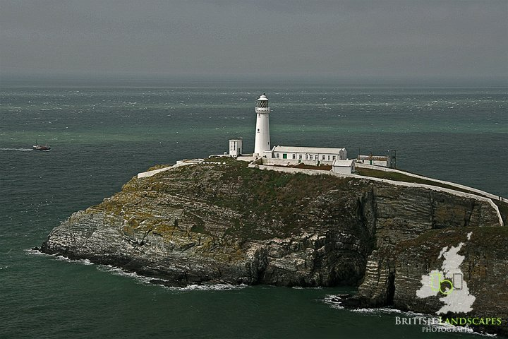 """Lighthouses around the British Coast - Part 2 3 As part of my British landscapes series of articles some while ago I took a look at some of the Lighthouses around the British Coast and now it's time to see more lighthouses that I have visited on my trips around the British Isles On this occasion I visit two on the """"Royal Island"""" - Anglesey, one each in South Devon and the Isle of Wight and one in the Scottish Highlands. I'll start off on the Isle of Anglesey and its most famous lighthouse South Stack. Situated near the north-west tip of Wales, the tiny islet known as South Stack Rock lies separated from Holyhead Island by 30 metres of the turbulent sea, surging to and fro in continuous motion. The coastline from the breakwater and around the southwestern shore is made of large granite cliffs rising sheer from the sea to 60 metres. The South Stack Lighthouse has warned passing ships of the treacherous rocks below since its completion in 1809. The sleeve for the Roxy Music album 'Siren' featuring Jerry Hall was shot on the rocks below South Stack during the summer of 1975."""